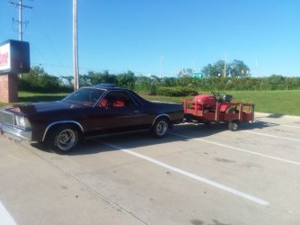 78 el Camino hauling trailer with red mowers.jpeg